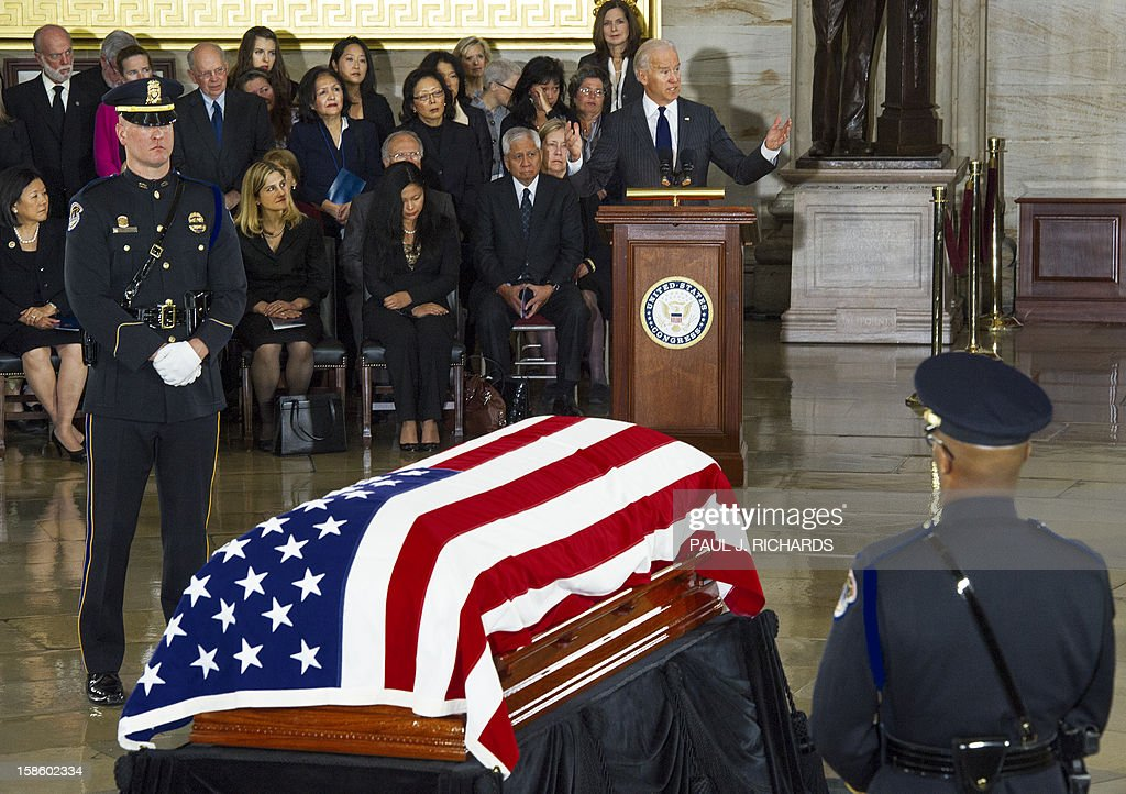 US Vice President Joe Biden speaks as the body of US Senator Daniel K. Inouye, (D-HI) is seen Lying in State with a flag draped casked on the floor of the US Capitol Rotunda on December 20, 2012, in Washington, DC. Inouye, one of the last World War II heroes in Congress and the longest-serving member of the US Senate, having represented Hawaii since the state joined the union in 1959, died at age 88. AFP PHOTO/Paul J. Richards