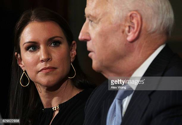 S Vice President Joe Biden speaks during a roundtable on the Cancer Moonshot Initiative as WWE Chief Brand Officer Stephanie McMahon looks on...