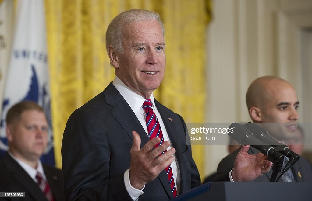 US Vice President Joe Biden speaks during an event highlighting Joining Forces hiring initiative for military veterans and spouses in civilian jobs in the East Room of the White House in Washington, DC, on April 30, 2013. Since President Obama challenged American businesses to hire US military veterans and spouses in August 2011, they have hired or trained 290,000 military veterans and spouses and now pledge to hire or train an additional 435,000 veterans and military spouses by 2018. AFP PHOTO / Saul LOEB