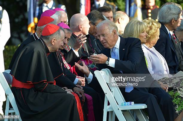 US Vice President Joe Biden speaks with clergy before the arrival of Pope Francis at the White House on September 23 2015 in WashingtonDC President...