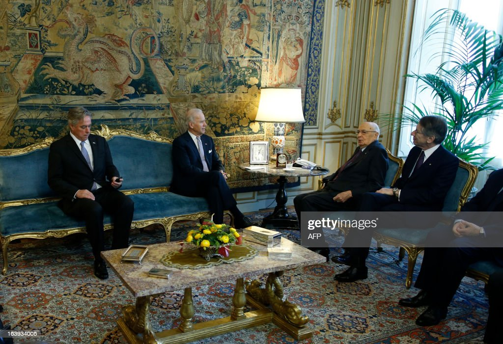 U.S. Vice President Joe Biden speaks with Italy's President Giorgio Napolitano (2ndR) at the Quirinale palace in Rome on March 18, 2013. Biden is in Italy to attend the inaugural mass of newly-elected Pope Francis, which is to be held at the Vatican on Tuesday.