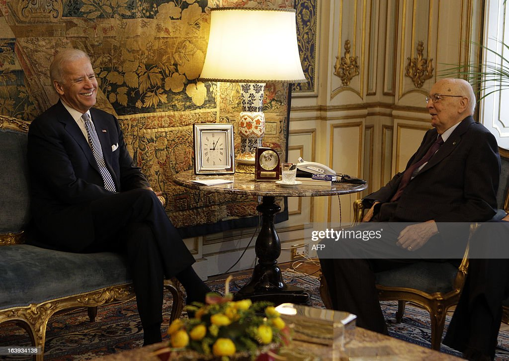 U.S. Vice President Joe Biden speaks with Italy's President Giorgio Napolitano (R) during a meeting at the Quirinale palace in Rome on March 18, 2013. Biden is in Italy to attend the inaugural mass of newly-elected Pope Francis, which is to be held at the Vatican on Tuesday.