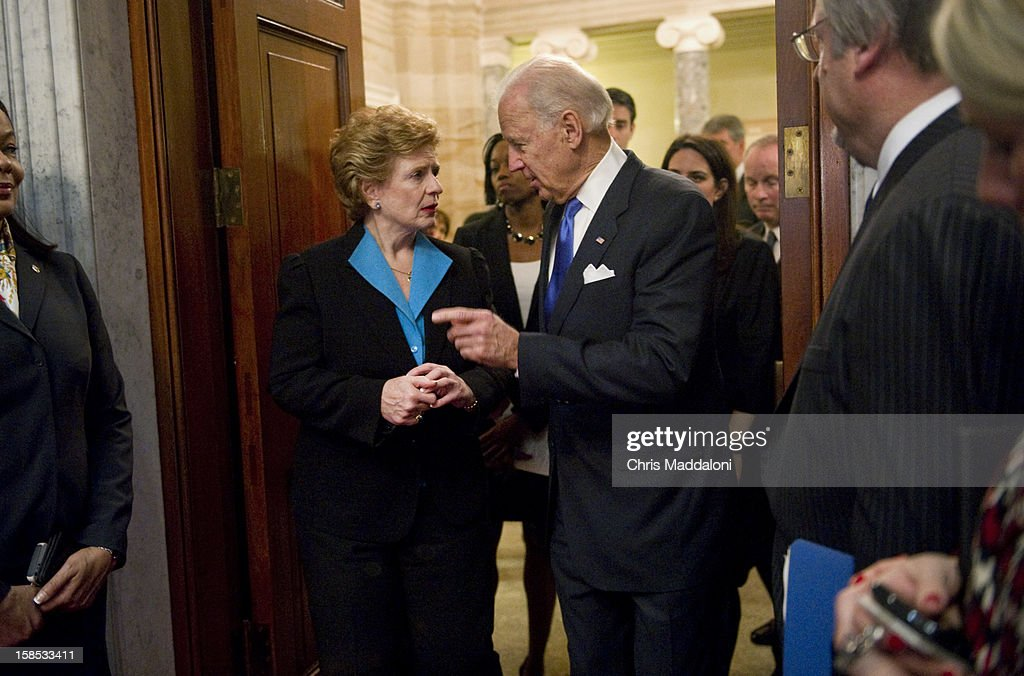 Vice President Joe Biden speaks with Sen. Debbie Stabenow, D-Mich., before conducting a mock swearing-in ceremony in the Old Senate Chamber for Sen. Patrick Leahy, D-Vt. to be sworn-in as president pro tempore of the Senate. Leahy replaced the late Sen. Daniel Inouye, D-Hawaii, who passed away on December 17, 2012.