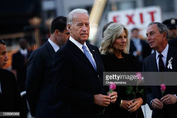 Vice President Joe Biden stands next to his wife Jill Biden and New York Mayor Mike Bloomberg before dropping flowers into a reflecting pool in the...