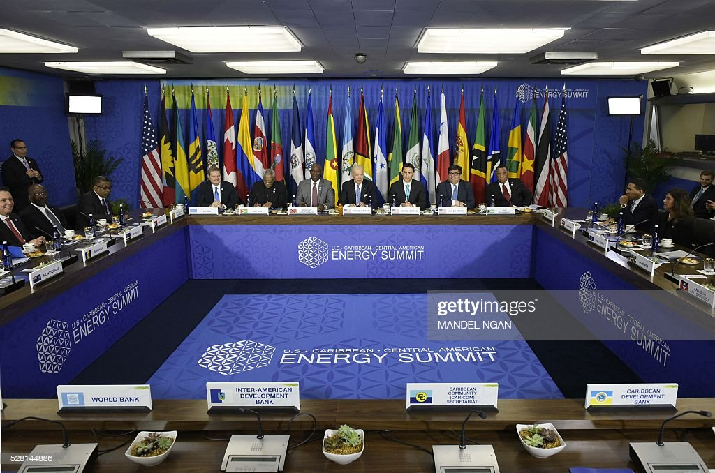 US Vice President Joe Biden takes part in a meeting with Caribbean heads of delegations during the US, Caribbean, Central American Energy Summit at the State Department in Washington, DC on May 4, 2016. From left, Aruba's Prime Minister Mike Eman, Guyana's President David Granger, Trinidad and Tobago Prime Minister Keith Rowley, Biden, US Bureau of Energy Resources Special Envoy Amos Hochstein, Principal Deputy Assistant Secretary for Bureau of Western Hemisphere Affairs Francisco Palmieri and Bahamas Prime Minister Gladstone. / AFP / MANDEL