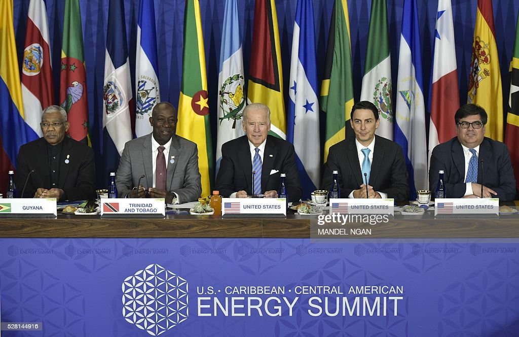 US Vice President Joe Biden takes part in a meeting with Caribbean heads of delegations during the US, Caribbean, Central American Energy Summit at the State Department in Washington, DC on May 4, 2016. Guyana's President David Granger, Trinidad and Tobago Prime Minister Keith Rowley, Biden, US Bureau of Energy Resources Special Envoy Amos Hochstein, and Principal Deputy Assistant Secretary for Bureau of Western Hemisphere Affairs Francisco Palmieri. / AFP / MANDEL