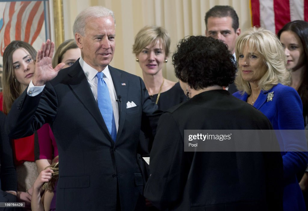 U.S. Vice President Joe Biden (2nd L) takes the oath of office from U.S. Supreme Court Justice <a gi-track='captionPersonalityLinkClicked' href=/galleries/search?phrase=Sonia+Sotomayor&family=editorial&specificpeople=5872777 ng-click='$event.stopPropagation()'>Sonia Sotomayor</a> (2nd R) as his wife Dr. <a gi-track='captionPersonalityLinkClicked' href=/galleries/search?phrase=Jill+Biden&family=editorial&specificpeople=997040 ng-click='$event.stopPropagation()'>Jill Biden</a> (R) looks on during the official swearing-in ceremony at the Naval Observatory on January 20, 2013 in Washington, DC. Biden and U.S. President Barack Obama will be officially sworn in a day before the ceremonial inaugural swearing-in.