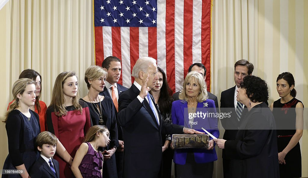 U.S. Vice President Joe Biden (7th R) takes the oath of office from U.S. Supreme Court Justice <a gi-track='captionPersonalityLinkClicked' href=/galleries/search?phrase=Sonia+Sotomayor&family=editorial&specificpeople=5872777 ng-click='$event.stopPropagation()'>Sonia Sotomayor</a> (2nd R) as his wife Dr. <a gi-track='captionPersonalityLinkClicked' href=/galleries/search?phrase=Jill+Biden&family=editorial&specificpeople=997040 ng-click='$event.stopPropagation()'>Jill Biden</a> (4th R) looks on during the official swearing-in ceremony at the Naval Observatory on January 20, 2013 in Washington, DC. Biden and U.S. President Barack Obama will be officially sworn in a day before the ceremonial inaugural swearing-in.