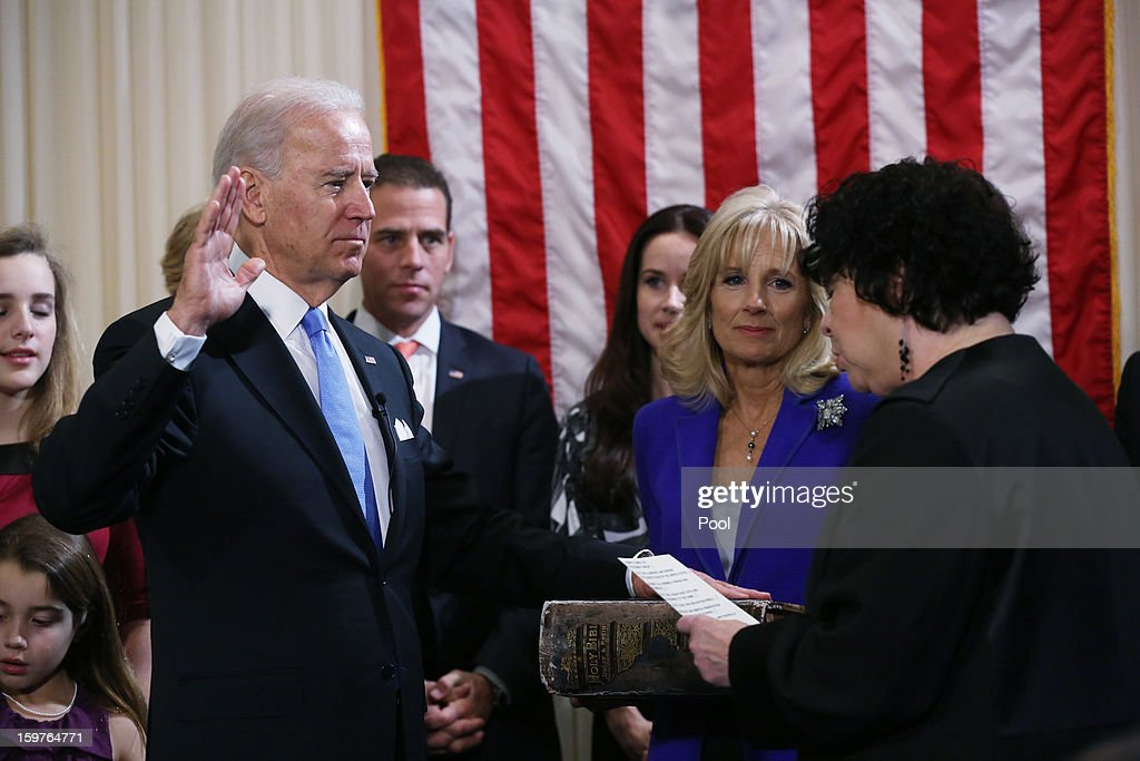 U.S. Vice President Joe Biden (L) takes the oath of office from U.S. Supreme Court Justice Sonia Sotomayor (R) as his wife Dr. Jill Biden looks on during the official swearing-in ceremony at the Naval Observatory on January 20, 2013 in Washington, DC. Biden and U.S. President Barack Obama will be officially sworn in a day before the ceremonial inaugural swearing-in.