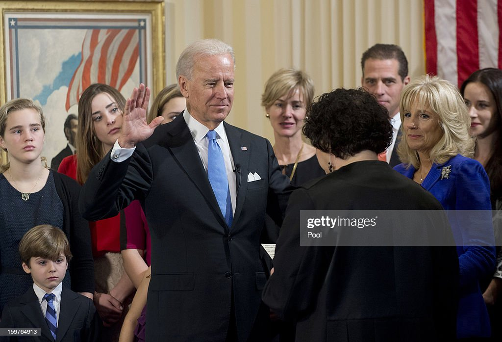 U.S. Vice President Joe Biden (4th L) takes the oath of office from U.S. Supreme Court Justice Sonia Sotomayor (3rd R) as his wife Dr. Jill Biden (2nd L) looks on during the official swearing-in ceremony at the Naval Observatory on January 20, 2013 in Washington, DC. Biden and U.S. President Barack Obama will be officially sworn in a day before the ceremonial inaugural swearing-in.