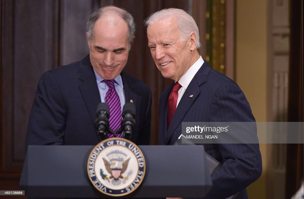 US Vice President Joe Biden (R) takes to the lectern after his introduction by Senator Bob Casey (L), D-PA, during an event with members of Congress to highlight the benefits of the ABLE (Achieving Better Life Expectancy) Act in the Eisenhower Executive Office Building, next to the White House on February 10, 2015 in Washington, DC.