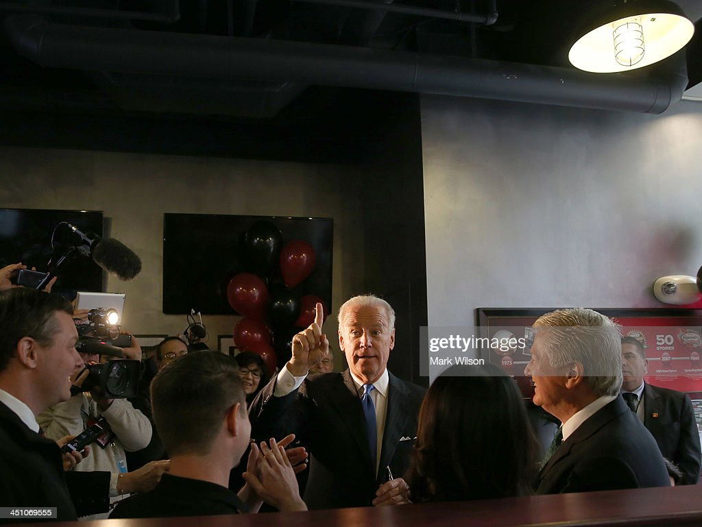 Vice President Joe Biden talks to customers while picking up his lunch at Capriotti's sandwhich shop, on November 21, 2013 in Washington, DC. Capriotti's is a Delaware based Italian hoagie chain and a favorite of the Vice President.