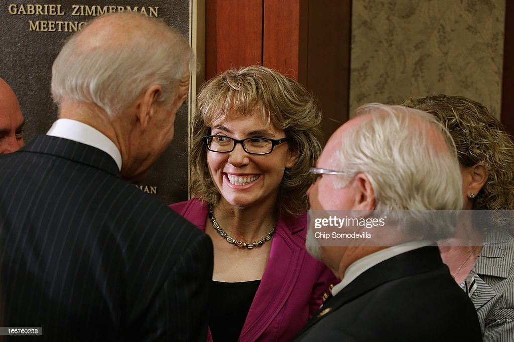 U.S. Vice President Joe Biden (L) talks with former Rep. <a gi-track='captionPersonalityLinkClicked' href=/galleries/search?phrase=Gabrielle+Giffords&family=editorial&specificpeople=6961081 ng-click='$event.stopPropagation()'>Gabrielle Giffords</a> (D-AZ) (C) and Rep. Ron Barber (D-AZ) after the dedication ceremony of the Gabriel Zimmerman Meeting Room in the U.S. Capitol Visitors Center April 16, 2013 in Washington, DC. A member of Giffords' Congressional staff, Zimmerman was murdered during a shooting spree January 8, 2011 that left six dead and 13 injured, including Giffords.
