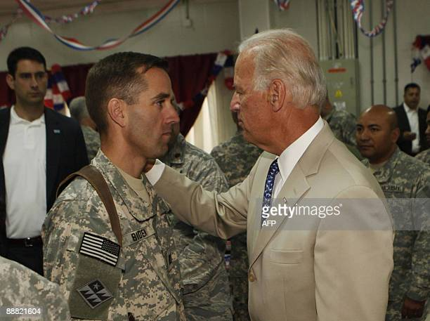 US Vice President Joe Biden talks with his son US Army Capt Beau Biden at Camp Victory on the outskirts of Baghdad on July 4 2009 Biden said that...