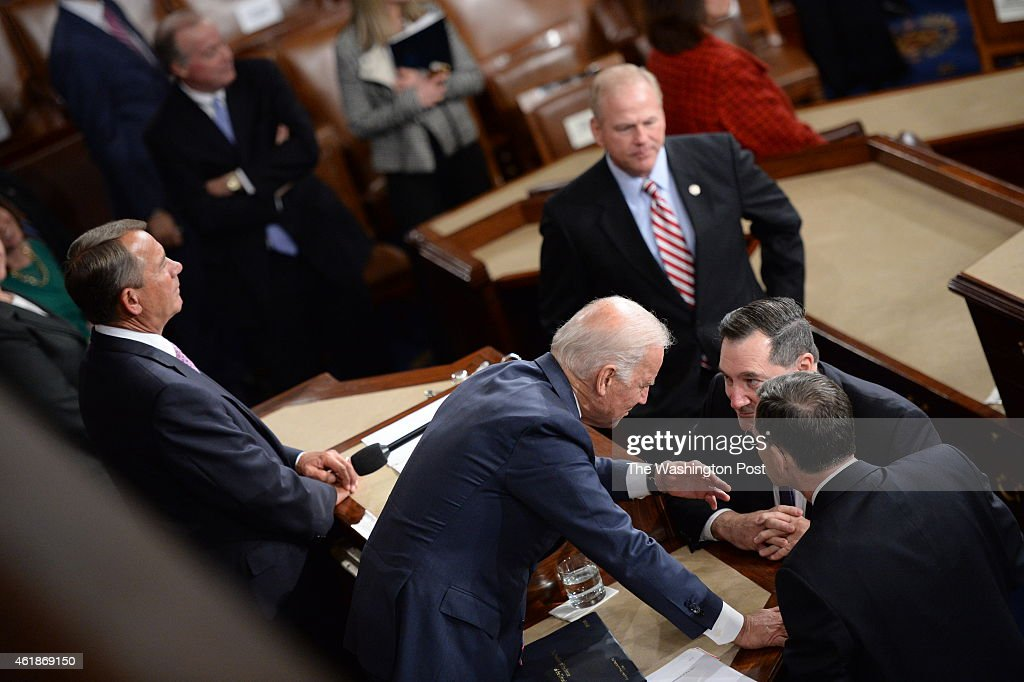 Vice President Joe Biden talks with Senator <a gi-track='captionPersonalityLinkClicked' href=/galleries/search?phrase=Joe+Donnelly&family=editorial&specificpeople=3269744 ng-click='$event.stopPropagation()'>Joe Donnelly</a> at the U.S. Capitol after President <a gi-track='captionPersonalityLinkClicked' href=/galleries/search?phrase=Barack+Obama&family=editorial&specificpeople=203260 ng-click='$event.stopPropagation()'>Barack Obama</a> delivered his State of the Union address before a joint session of Congress on Tuesday, January 20, 2015 in Washington, DC..