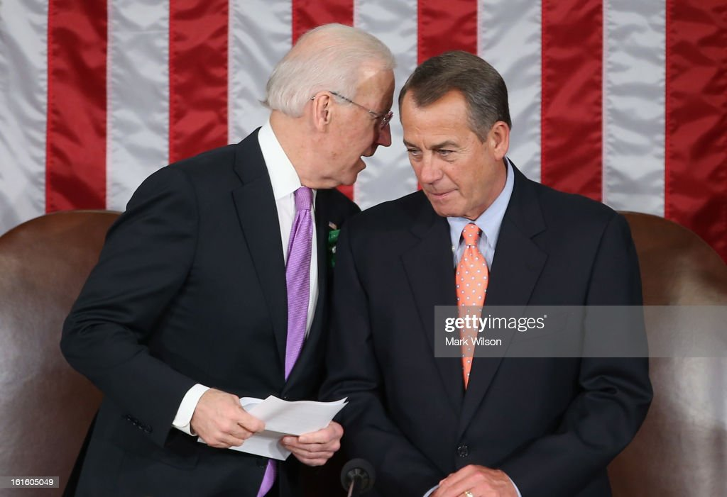U.S. Vice President Joe Biden (L) talks with Speaker of the House Johen Boehner (R-OH) before U.S. President Barack Obama's State of the Union address February 12, 2013 in Washington, DC. Facing a divided Congress, Obama is expected to focus his speech on new initiatives designed to stimulate the U.S. economy.