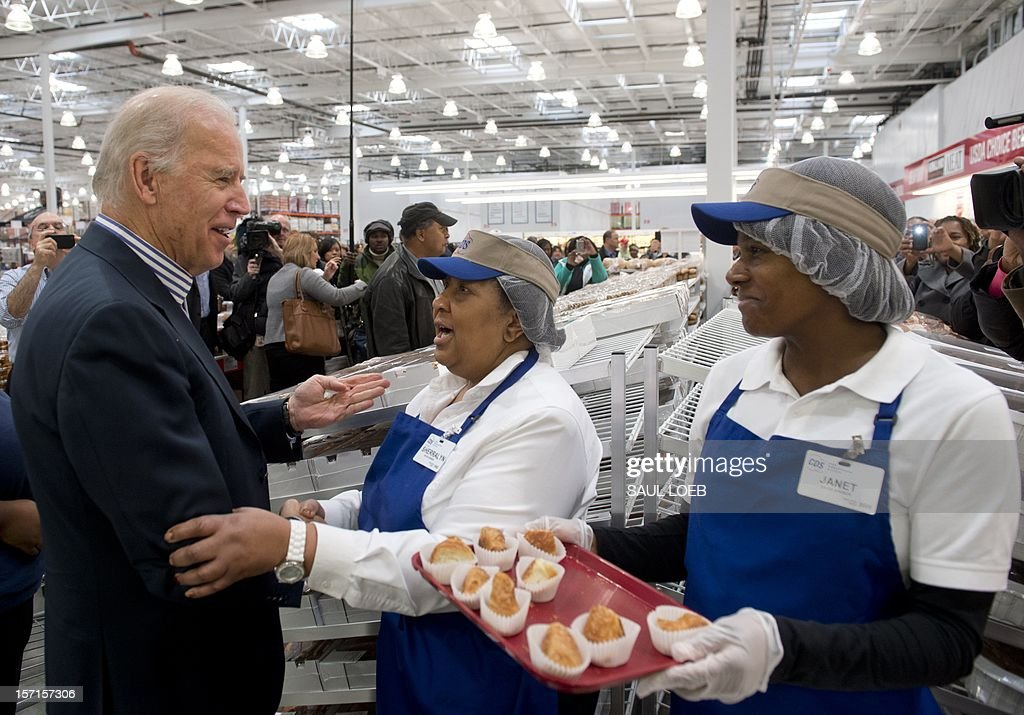 US Vice President Joe Biden tries food samples during a visit to a Costco store on a shopping trip in Washington, DC, on November 29, 2012. Biden made the visit to the first Costco store located in Washington, DC, during its grand opening. AFP PHOTO / Saul LOEB