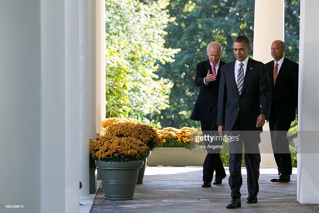 U.S. Vice President Joe Biden (L) U. S. President <a gi-track='captionPersonalityLinkClicked' href=/galleries/search?phrase=Barack+Obama&family=editorial&specificpeople=203260 ng-click='$event.stopPropagation()'>Barack Obama</a> (C) and Jeh Johnson walk to the Rose Garden at the White House,for a ceremony to introduce Johnson as the Secretary of the Department of Homeland Security, October 18, 2013 in Washington, DC. The Department of Homeland Security has been without a Senate-confirmed leader for six weeks.