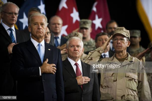 S Vice President Joe Biden US Secretary of Defense Robert Gates and Chairman of the Joint Chiefs Admiral Mike Mullen stand during the US national...
