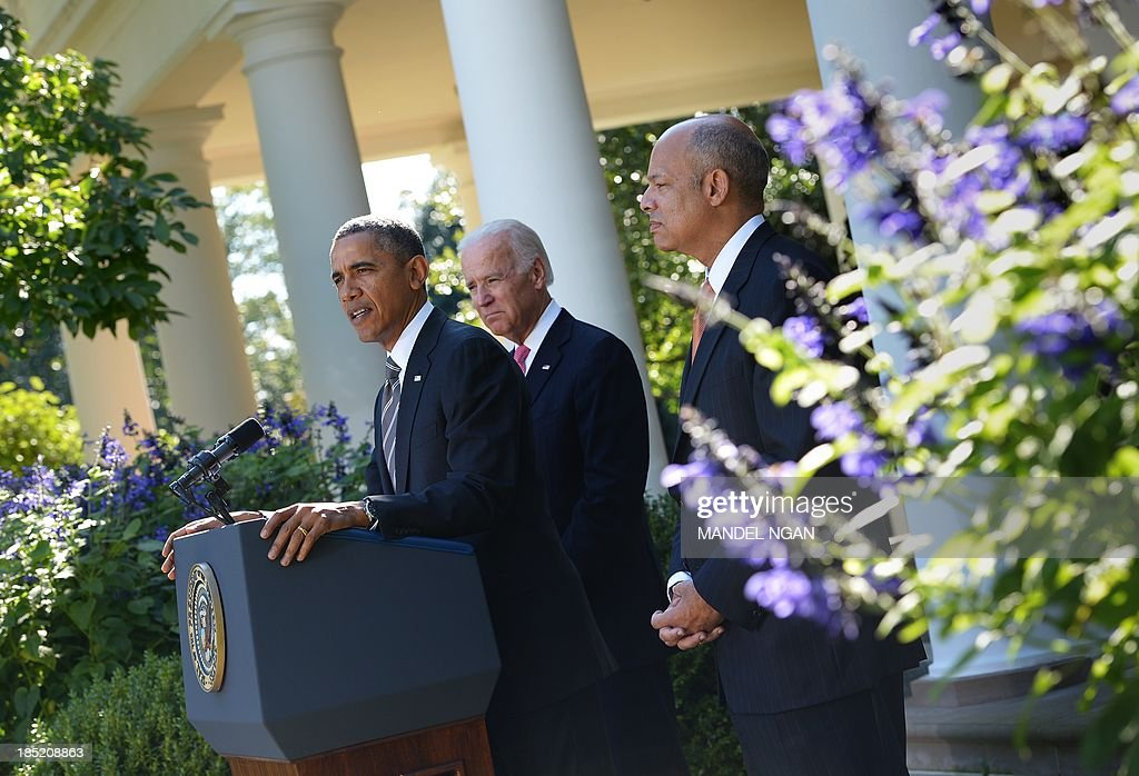 US Vice President Joe Biden (C) watches as US President <a gi-track='captionPersonalityLinkClicked' href=/galleries/search?phrase=Barack+Obama&family=editorial&specificpeople=203260 ng-click='$event.stopPropagation()'>Barack Obama</a> (L) speaks as he announces Jeh Johnson (R) as his choice to be the next homeland security secretary during a press conference in the Rose Garden of the White House on October 18, 2013 in Washington. AFP PHOTO/Mandel NGAN