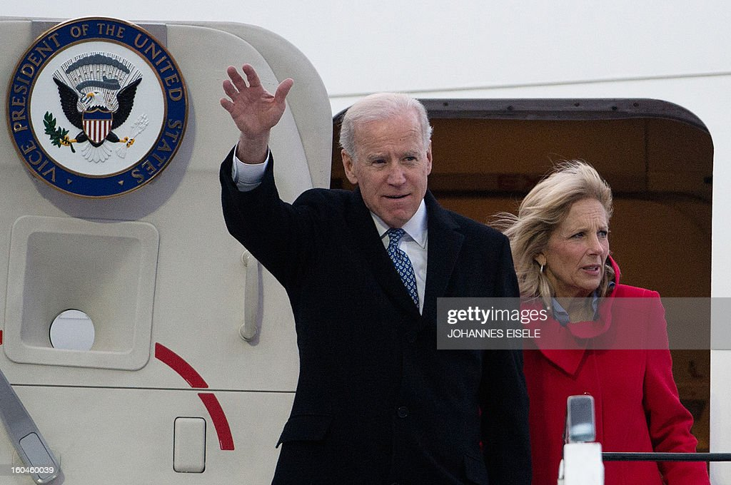 US Vice President Joe Biden waves as he gets out of his plane with his wife Jill Biden upon arrival at the Tegel military airport in Berlin on February 1, 2013. Biden is to meet German Chancellor Angela Merkel for talks ahead of the Munich Security Conference. EISELE