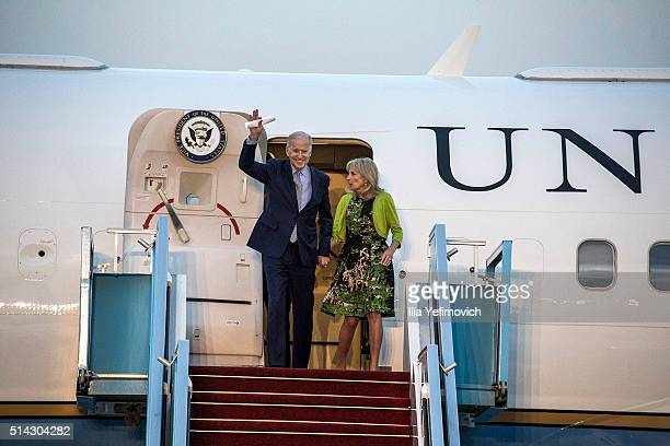 S Vice President Joe Biden waves with his wife Dr Jill Biden as they walk out of the plane at BenGurion airport on March 8 2016 in Tel Aviv Israel US...
