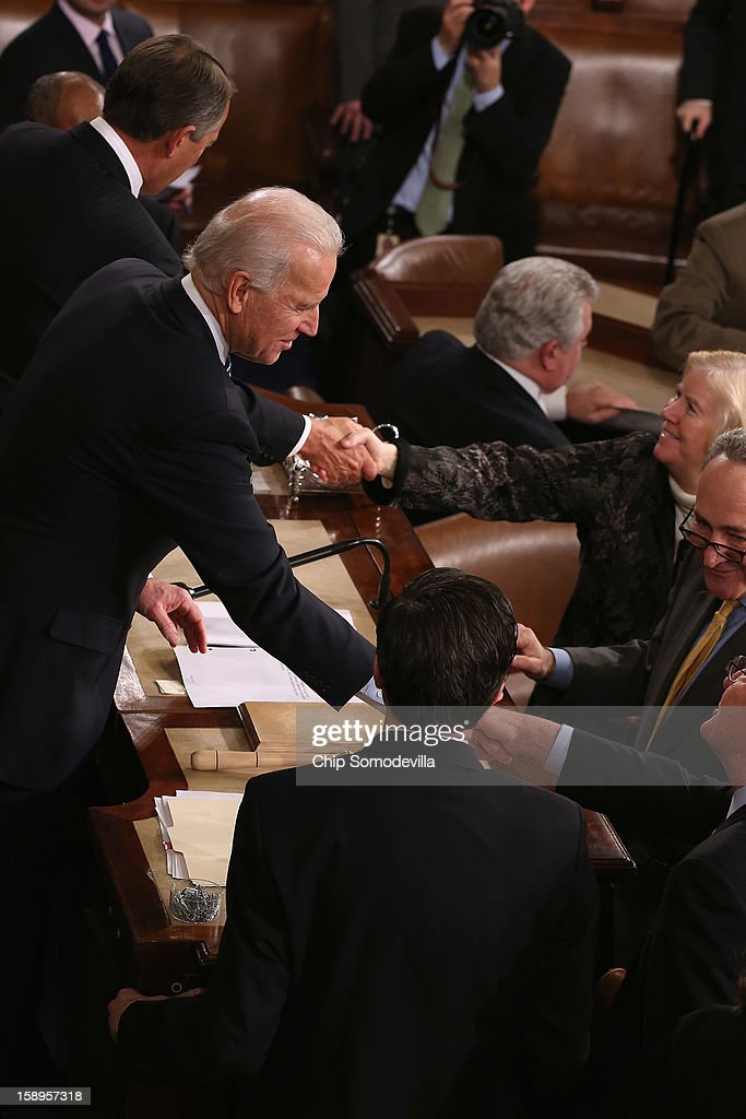 Vice President Joe Biden, who is also the president of the Senate, thanks legislators and clerks after counting the Electorial College votes from the 50 states in the House of Representatives chamber at the U.S. Capitol January 4, 2013 in Washington, DC. The votes were tallied during a joint session of the 113th Congress. President Barack Obama and Biden received 332 votes to be reelected.