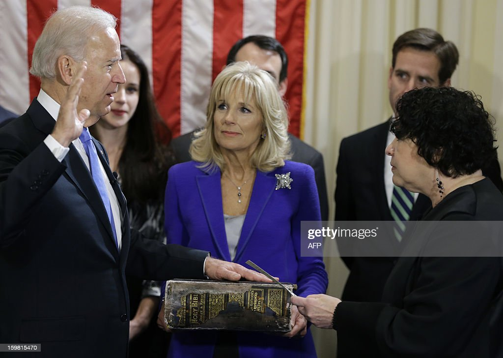 US Vice President Joe Biden (L), with his wife Jill Biden (C), holding the Biden family Bible, takes the oath of office from Supreme Court Justice Sonia Sotomayor during an official ceremony at the Naval Observatory on January 20, 2013 in Washington. AFP PHOTO/POOL/Carolyn Kaster