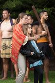 US Vice President Joe Biden's granddaughters 21yearold Naomi Biden and 12yearold Natalie Biden look on as a guard of honour is presented during a...