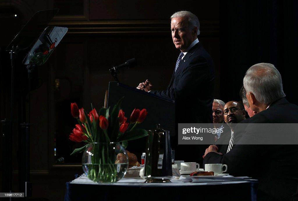 U.S. Vice President <a gi-track='captionPersonalityLinkClicked' href=/galleries/search?phrase=Joseph+Biden&family=editorial&specificpeople=206897 ng-click='$event.stopPropagation()'>Joseph Biden</a> (L) addresses the 81st Winter Meeting of the U.S. Conference of Mayors (USCM) as USCM President and Mayor of Philadelphia Michael Nutter (R) looks on at Capital Hilton Hotel January 17, 2013 in Washington, DC. Biden delivered remarks on gun control during the opening plenary luncheon of the meeting.