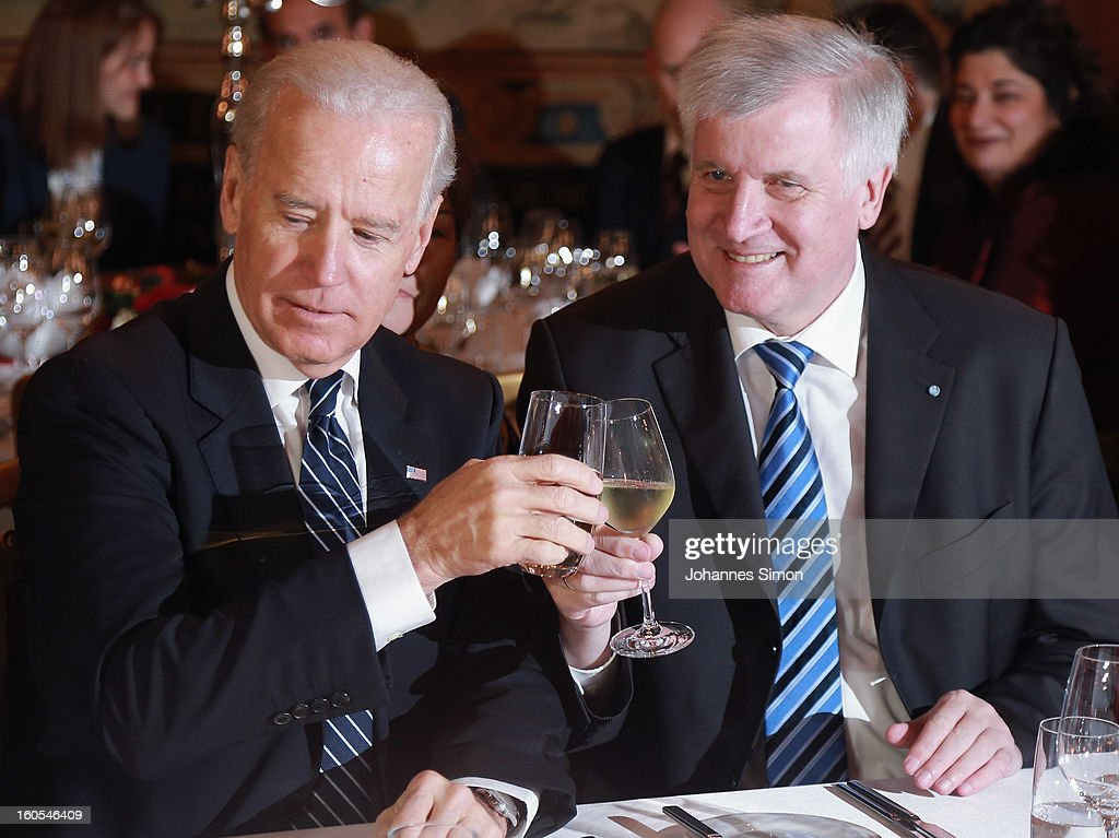 U.S. Vice President Joseph Biden (L) and Bavarian state governor Horst Seehofer cheer with wine glasses during a gala dinner for the participants of the Munich conference on security policy on February 2, 2013 in Munich, Germany. The Munich Security Conference brings together senior figures from around the world to engage in an intensive debate on current and future security challenges and remains the most important independent forum for the exchange of views by international security policy decision-makers.
