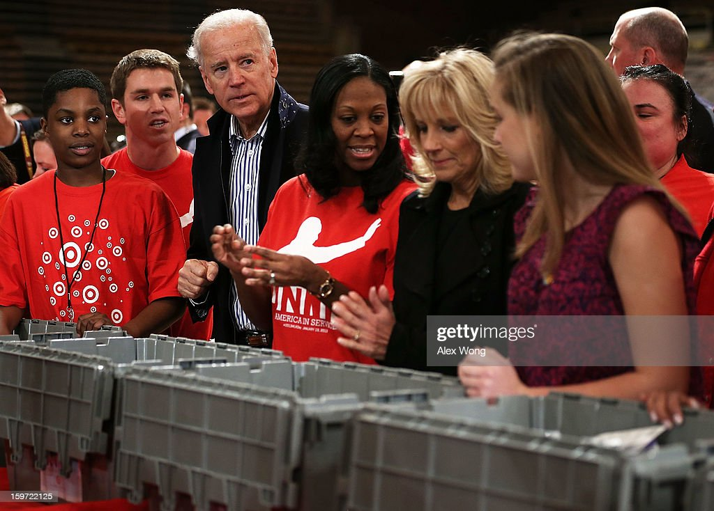 U.S. Vice President <a gi-track='captionPersonalityLinkClicked' href=/galleries/search?phrase=Joseph+Biden&family=editorial&specificpeople=206897 ng-click='$event.stopPropagation()'>Joseph Biden</a> (3rd L) and his wife <a gi-track='captionPersonalityLinkClicked' href=/galleries/search?phrase=Jill+Biden&family=editorial&specificpeople=997040 ng-click='$event.stopPropagation()'>Jill Biden</a> (2nd R) participate during a Unite America in Service event on the National Day of Service as part of the 57th Presidential Inauguration January 19, 2013 at the DC Armory in Washington, DC. Vice President Biden and his family joined volunteers to pack care kits filled with necessities for deployed U.S. Service Members, Wounded Warriors, Veterans and First Responders.