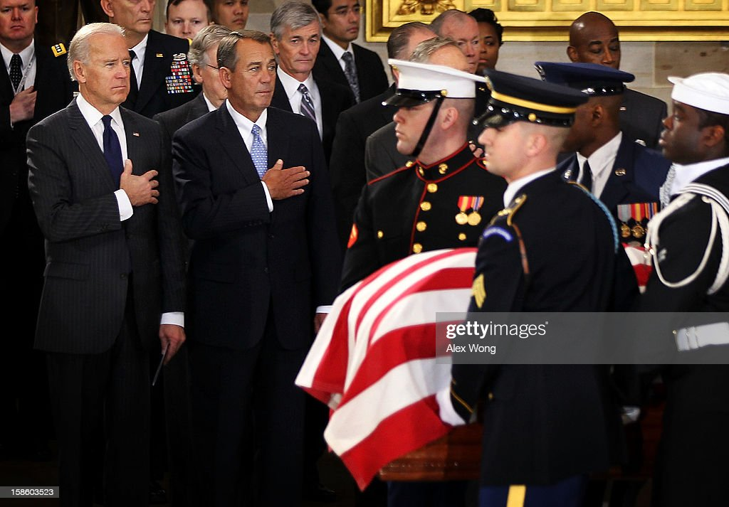 U.S. Vice President Joseph Biden (L) and Speaker of the House Rep. John Boehner (R-OH) (2nd L) put their hands atop their hearts as the flag draped casket of Senator Daniel Inouye (D-HI) arrives at the Rotunda of the U.S. Capitol for a lying in state during a service December 20, 2012 on Capitol Hill in Washington, DC. The late Senator had died at the age of 88 on Monday at the Walter Reed National Military Medical Center in Bethesda, Maryland where he had been hospitalized since early December. A public funeral service will be held at the Washington National Cathedral on Friday for Senator Inouye, a World War II veteran and the second-longest serving senator in history. His remains will be returned and laid to rest in his home state.