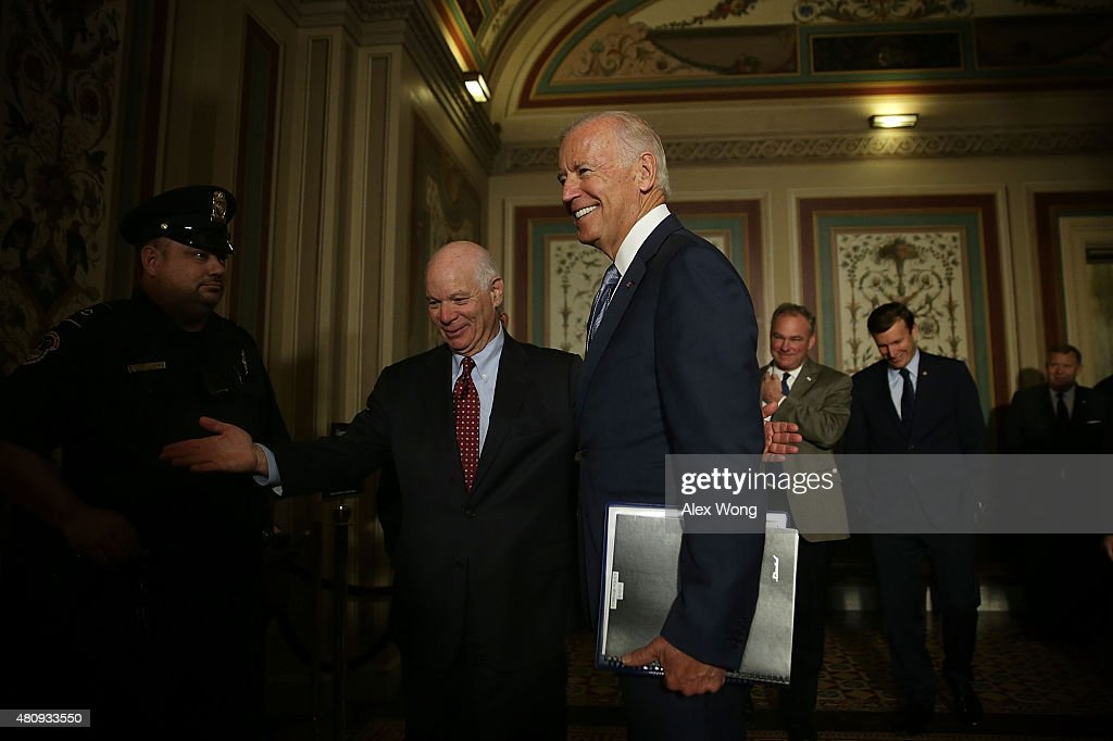 U.S. Vice President Joseph Biden (2nd L) arrives at a meeting with Senate Foreign Relations Committee members as he is welcomed by Sen. Ben Cardin (D-MD) (L) July 16, 2015 at the U.S. Capitol in Washington, DC. Vice President Biden was on the Hill to pitch the Iran nuclear deal. Sen. Tim Kaine (D-VA) (3rd L) and Sen. Chris Murphy (D-CT) (4th L) also attended the meeting.