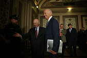 S Vice President Joseph Biden arrives at a meeting with Senate Foreign Relations Committee members as he is welcomed by Sen Ben Cardin July 16 2015...