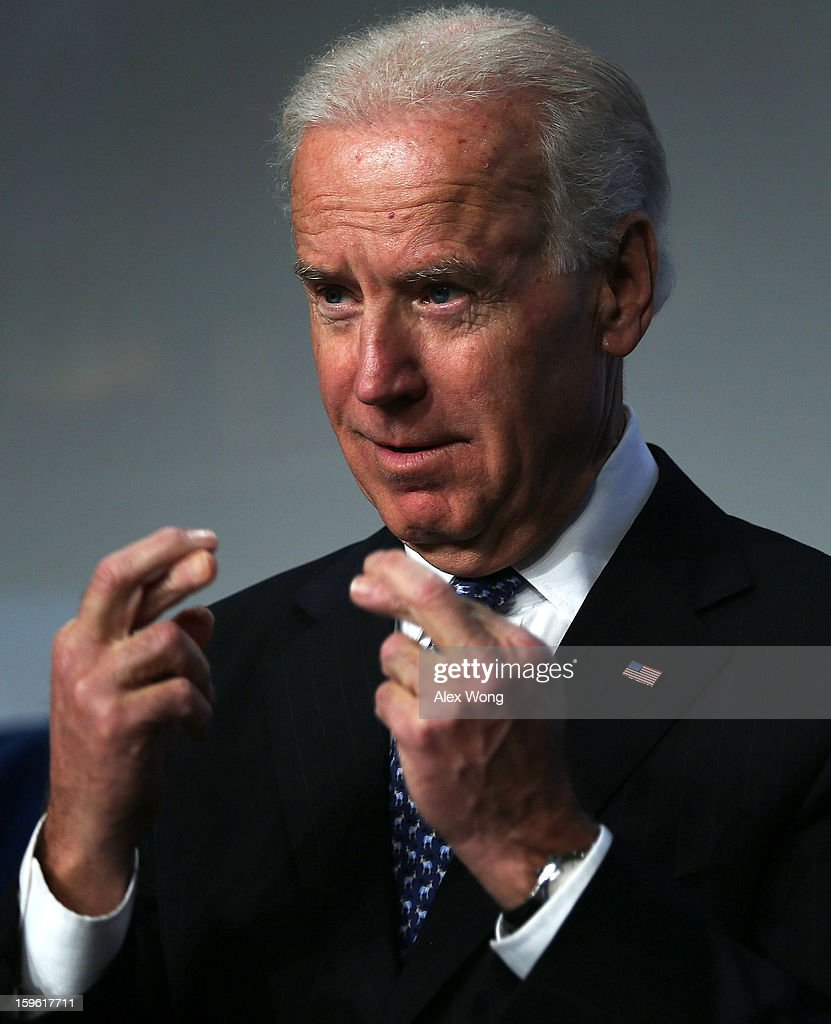 U.S. Vice President <a gi-track='captionPersonalityLinkClicked' href=/galleries/search?phrase=Joseph+Biden&family=editorial&specificpeople=206897 ng-click='$event.stopPropagation()'>Joseph Biden</a> gestures as he is introduced during the 81st Winter Meeting of the U.S. Conference of Mayors (USCM) at Capital Hilton Hotel January 17, 2013 in Washington, DC. Biden delivered remarks on gun control during the opening plenary luncheon of the meeting.