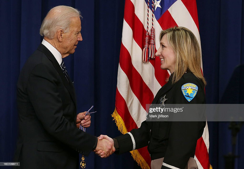 Vice President Joseph Biden gives the Medal of Valor to Deputy Sheriff Krista McDonald of the Kitsap County Washington Sheriff's Office, during an event in Eisenhower Executive Office Building, February 20, 2013 in Washington, DC. Vice President Biden presented the award to public safety officers who have exhibited exceptional courage, regardless of personal safety, in the attempt to save or protect others from harm.
