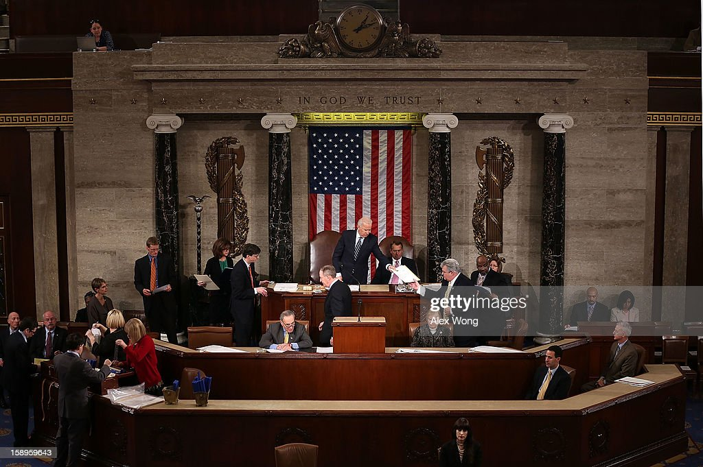 U.S. Vice President Joseph Biden (L) hands a vote certificate to Rep. Robert Brady (D-PA) (R) as Speaker of the House Rep. John Boehner (R-OH) (C) looks on during a joint session of the 113th Congress to count the Electoral College votes January 4, 2013 on Capitol Hill in Washington, DC. The Senate and the House held a joint session to count the Electoral College votes for the 2012 presidential election.