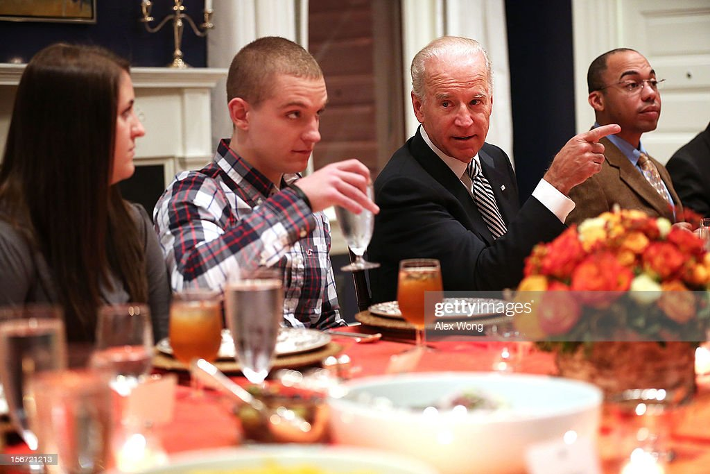U.S. Vice President <a gi-track='captionPersonalityLinkClicked' href=/galleries/search?phrase=Joseph+Biden&family=editorial&specificpeople=206897 ng-click='$event.stopPropagation()'>Joseph Biden</a> (3rd R) hosts Wounded Warriors, including Lance Corporal Nathan Jakubisin (2nd L) and wife Marli (L), and Staff Sergeant Darryl Fletcher (R), for an early Thanksgiving Dinner November 19, 2012 at the Vice President's residence at the Naval Observatory in Washington, DC. Biden continued a tradition to host the 4th annual dinner for Wounded Warriors being treated at the Walter Reed National Military Medical Center and their families who will not be able to leave the DC area to be with family for the holiday.