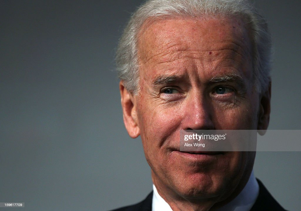 U.S. Vice President <a gi-track='captionPersonalityLinkClicked' href=/galleries/search?phrase=Joseph+Biden&family=editorial&specificpeople=206897 ng-click='$event.stopPropagation()'>Joseph Biden</a> listens as he is introduced during the 81st Winter Meeting of the U.S. Conference of Mayors (USCM) at Capital Hilton Hotel January 17, 2013 in Washington, DC. Biden delivered remarks on gun control during the opening plenary luncheon of the meeting.