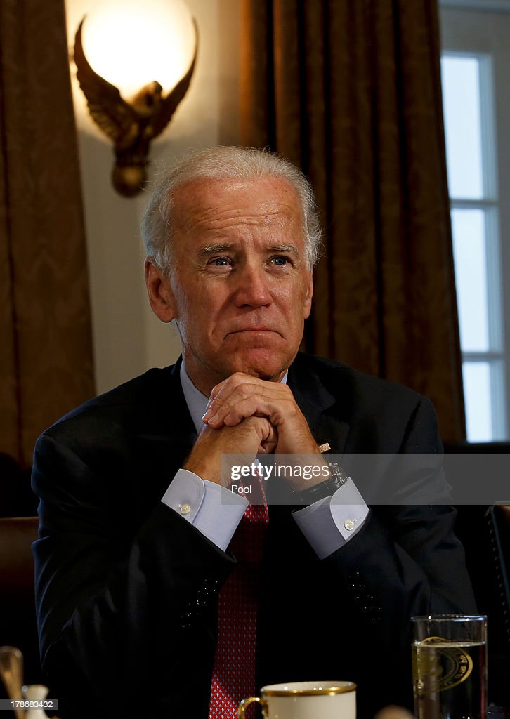 US Vice President <a gi-track='captionPersonalityLinkClicked' href=/galleries/search?phrase=Joseph+Biden&family=editorial&specificpeople=206897 ng-click='$event.stopPropagation()'>Joseph Biden</a> listens as US President Barack Obama welcomes President Toomas Hendrik Ilves of Estonia, President Dalia Grybauskaite of Lithuania, and President Andris Berzins of Latvia in the Cabinet Room of the White House August 30, 2013 in Washington, DC. A joint meeting was to be held that will highlight the transformations the Baltic States have undergone since restoring their independence two decades ago. President Obama spoke with the media about the ongoing situation in Syria.