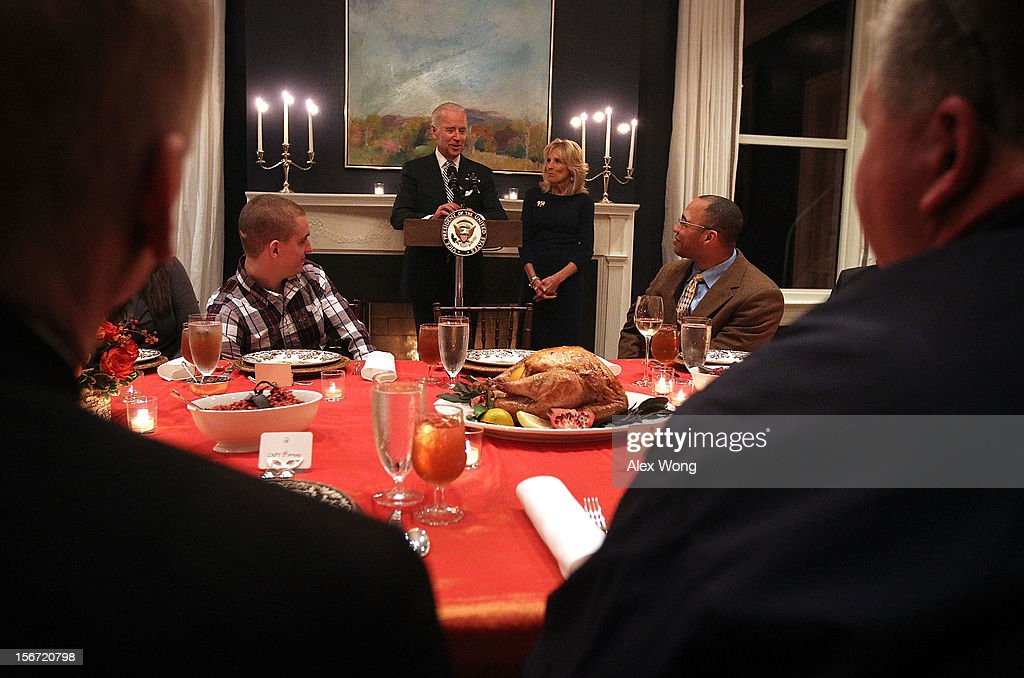 U.S. Vice President Joseph Biden (L) makes opening remarks as he and his wife Jill Biden (R) host Wounded Warriors for an early Thanksgiving Dinner November 19, 2012 at the Vice President's residence at the Naval Observatory in Washington, DC. The Bidens continued their tradition to host the 4th annual dinner for Wounded Warriors being treated at the Walter Reed National Military Medical Center and their families who will not be able to leave the DC area to be with family for the holiday.
