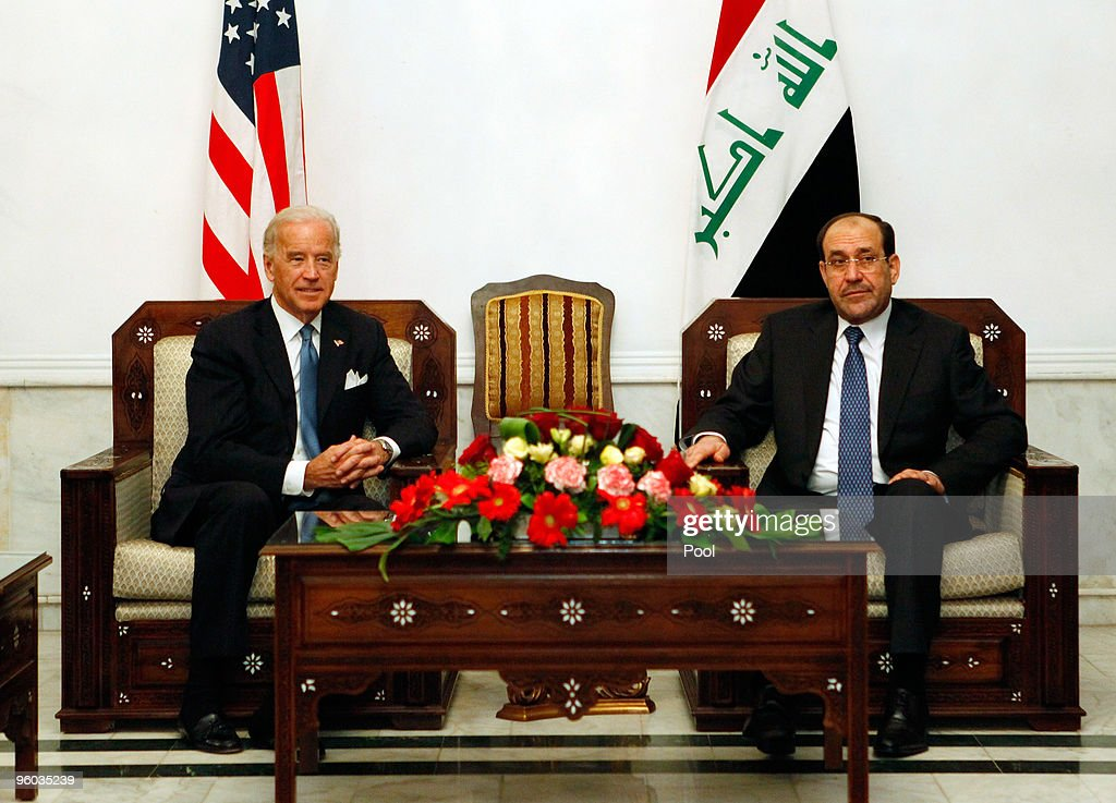 U.S. Vice President <a gi-track='captionPersonalityLinkClicked' href=/galleries/search?phrase=Joseph+Biden&family=editorial&specificpeople=206897 ng-click='$event.stopPropagation()'>Joseph Biden</a> (L) meets with Iraqi Prime Minister Nouri Maliki January 23, 2010 in Baghdad, Iraq. Vice President Joe Biden is holding talks with Iraqi leaders amid growing tensions over plans to ban election candidates because of suspected links to Saddam Hussein's regime.