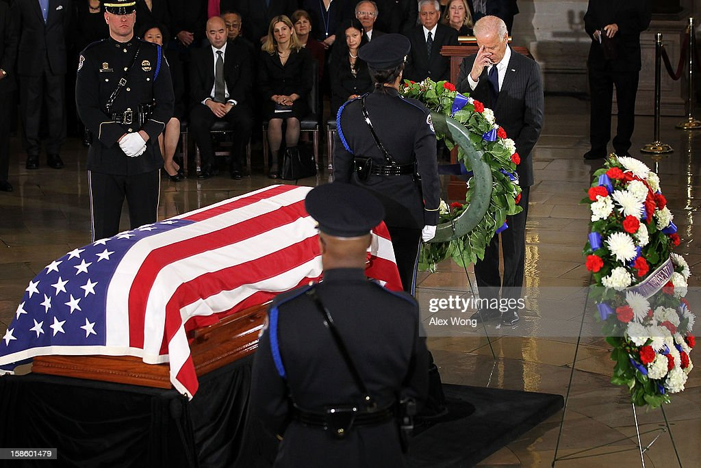 U.S. Vice President <a gi-track='captionPersonalityLinkClicked' href=/galleries/search?phrase=Joseph+Biden&family=editorial&specificpeople=206897 ng-click='$event.stopPropagation()'>Joseph Biden</a> places a wreath in front of the flag draped casket of Senator Daniel Inouye (D-HI) at the Rotunda of the U.S. Capitol during a service December 20, 2012 on Capitol Hill in Washington, DC. The late Senator had died at the age of 88 on Monday at the Walter Reed National Military Medical Center in Bethesda, Maryland where he had been hospitalized since early December. A public funeral service will be held at the Washington National Cathedral on Friday for Senator Inouye, a World War II veteran and the second-longest serving senator in history. His remains will be returned and laid to rest in his home state.