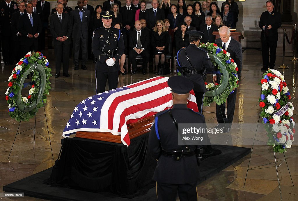 U.S. Vice President Joseph Biden places a wreath in front of the flag draped casket of Senator Daniel Inouye (D-HI) at the Rotunda of the U.S. Capitol during a service December 20, 2012 on Capitol Hill in Washington, DC. The late Senator had died at the age of 88 on Monday at the Walter Reed National Military Medical Center in Bethesda, Maryland where he had been hospitalized since early December. A public funeral service will be held at the Washington National Cathedral on Friday for Senator Inouye, a World War II veteran and the second-longest serving senator in history. His remains will be returned and laid to rest in his home state.