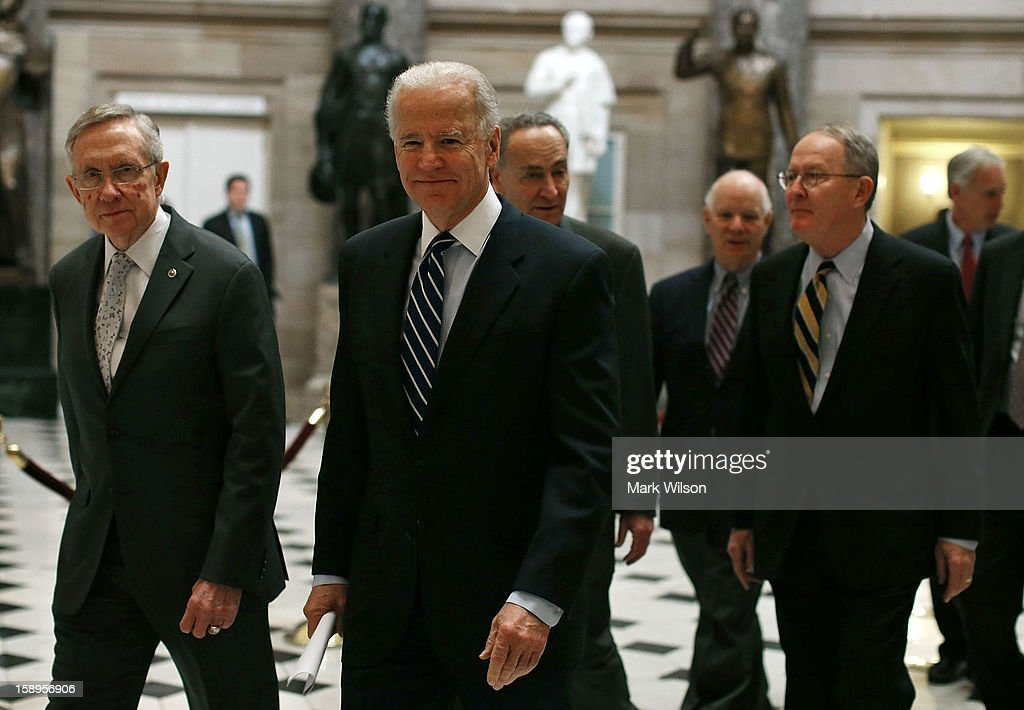 Vice President Joseph Biden (C), Senate Majority Leader Harry Reid (D-NV) (L) and members of the U.S. Senate escort the electoral votes through the halls of the U.S. Capitol to the House Chamber, on January 4, 2013 in Washington, DC. Congress assembled a joint session to count the electoral votes and declare the winners of the 2012 presidential election.