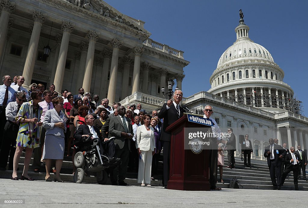 U.S. Vice President Joseph Biden speaks as Senate Minority Leader Sen. Harry Reid (D-NV), House Minority Leader Rep. Nancy Pelosi (D-CA) and other Senate and House Democrats listen during a press event on the House East Front Steps of the Capitol September 8, 2016 in Washington, DC. Congressional Democrats urge the Republicans to 'do your job!'
