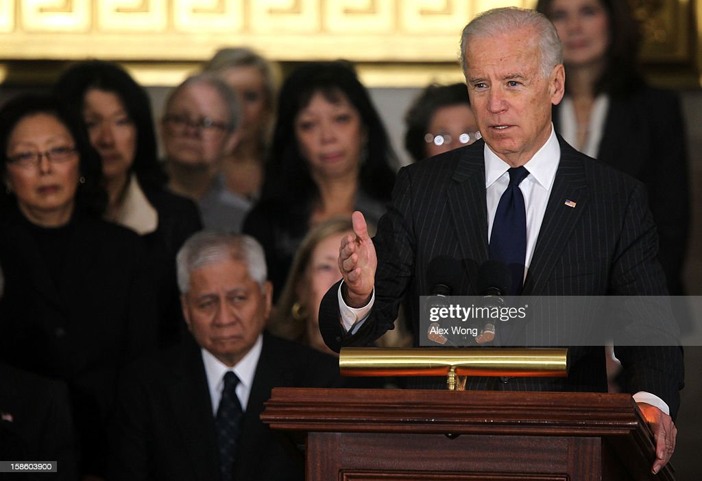 U.S. Vice President <a gi-track='captionPersonalityLinkClicked' href=/galleries/search?phrase=Joseph+Biden&family=editorial&specificpeople=206897 ng-click='$event.stopPropagation()'>Joseph Biden</a> speaks as Senator Daniel Inouye (D-HI) lies in state in the Rotunda of the U.S. Capitol during a service December 20, 2012 on Capitol Hill in Washington, DC. The late Senator had died at the age of 88 on Monday at the Walter Reed National Military Medical Center in Bethesda, Maryland where he had been hospitalized since early December. A public funeral service will be held at the Washington National Cathedral on Friday for Senator Inouye, a World War II veteran and the second-longest serving senator in history. His remains will be returned and laid to rest in his home state.