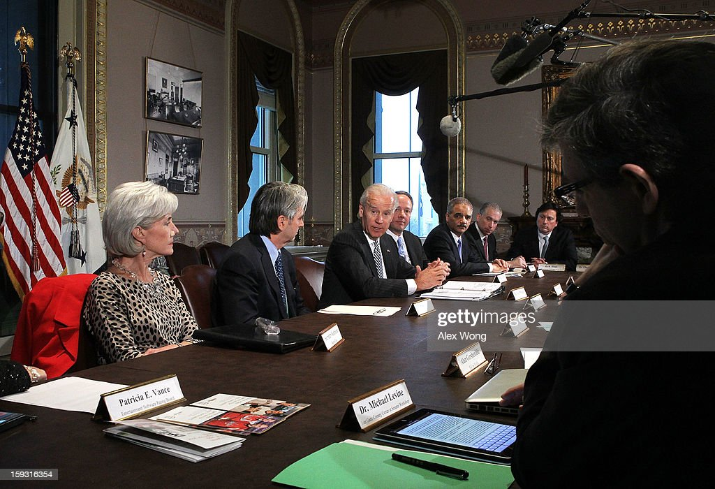 U.S. Vice President <a gi-track='captionPersonalityLinkClicked' href=/galleries/search?phrase=Joseph+Biden&family=editorial&specificpeople=206897 ng-click='$event.stopPropagation()'>Joseph Biden</a> (3rd L) speaks during a meeting with Attorney General <a gi-track='captionPersonalityLinkClicked' href=/galleries/search?phrase=Eric+Holder&family=editorial&specificpeople=1060367 ng-click='$event.stopPropagation()'>Eric Holder</a> (3rd R) and Secretary of Health and Human Services <a gi-track='captionPersonalityLinkClicked' href=/galleries/search?phrase=Kathleen+Sebelius&family=editorial&specificpeople=700528 ng-click='$event.stopPropagation()'>Kathleen Sebelius</a> (L) and representatives from the video game and entertainment industries January 11, 2013 at the Eisenhower Executive Office Building of the White House in Washington, DC. Biden continued his work on developing policy proposals in response to the shooting tragedy in Newtown, Connecticut. He will give his recommendations to President Barack Obama next week.