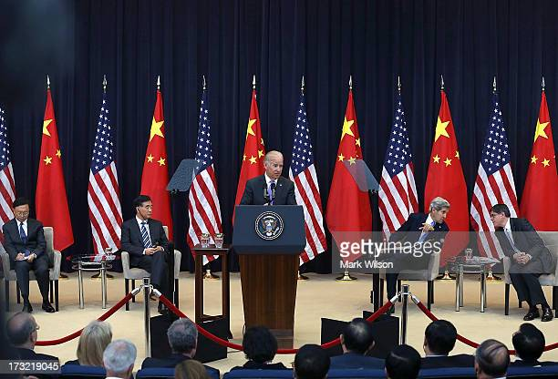 S Vice President Joseph Biden speaks while Chinese State Councilor Yang Jiechi Chinese Vice Premier Wang Qishan US Secretary of State John Kerry and...